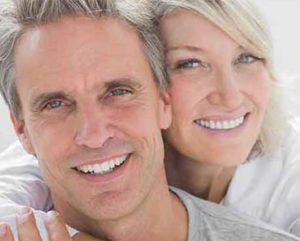 couple-with-dental-implants-smilling